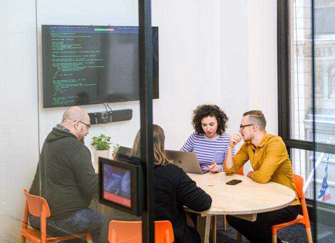 developers coding website in meeting room
