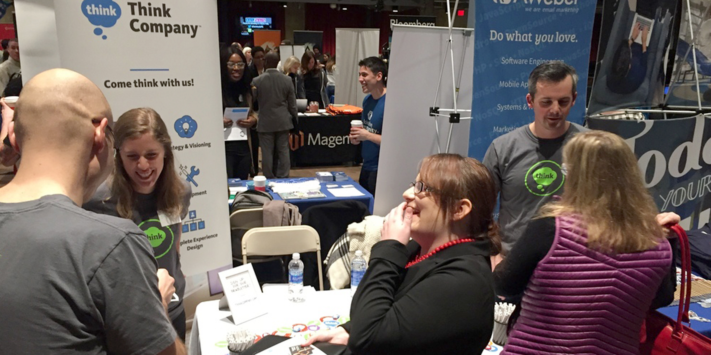 Photo of Think Company employees at job fair table
