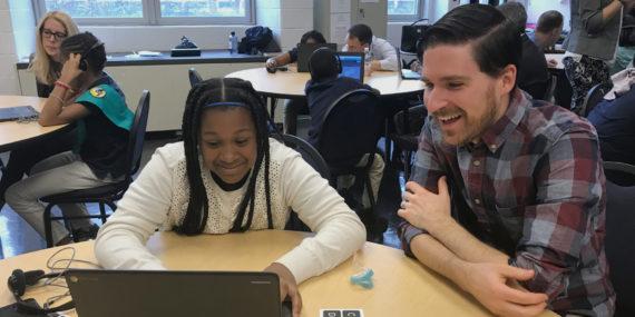 photo of Brendan McKeown helping student code