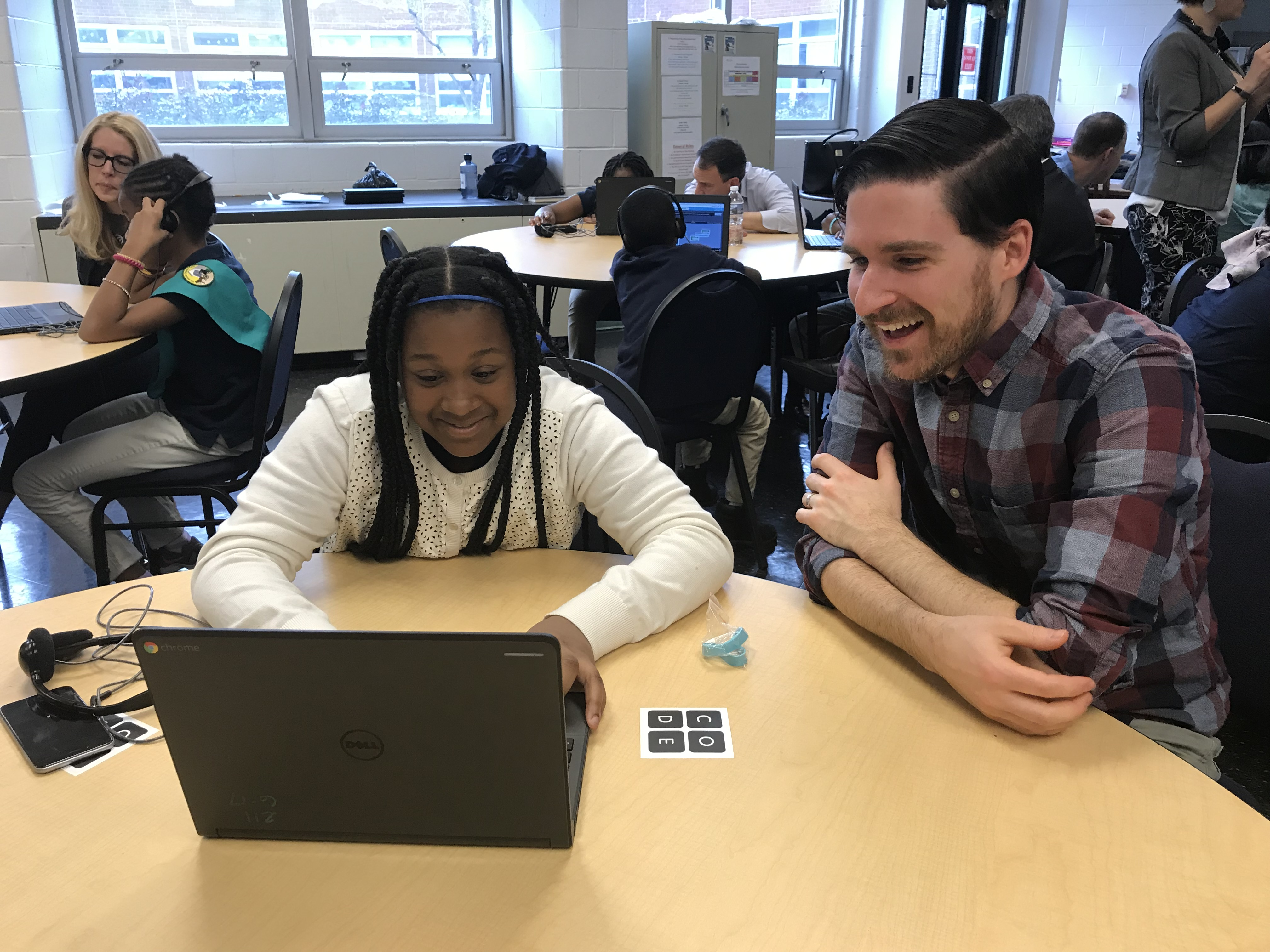 Senior UI Developer Brendan McKeown and a student at Dr. Ethel Allen School explore callback functions