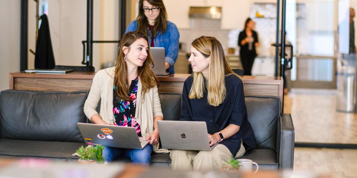 Photo of two women talking in an office