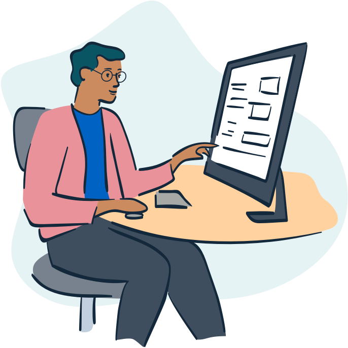 Person sitting and pointing at computer screen