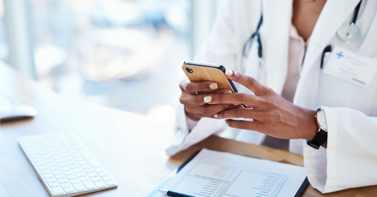 health care provider using her phone to look up medical information