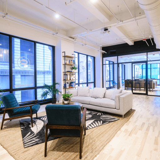 philadelphia studio chairs and couches in front of large windows